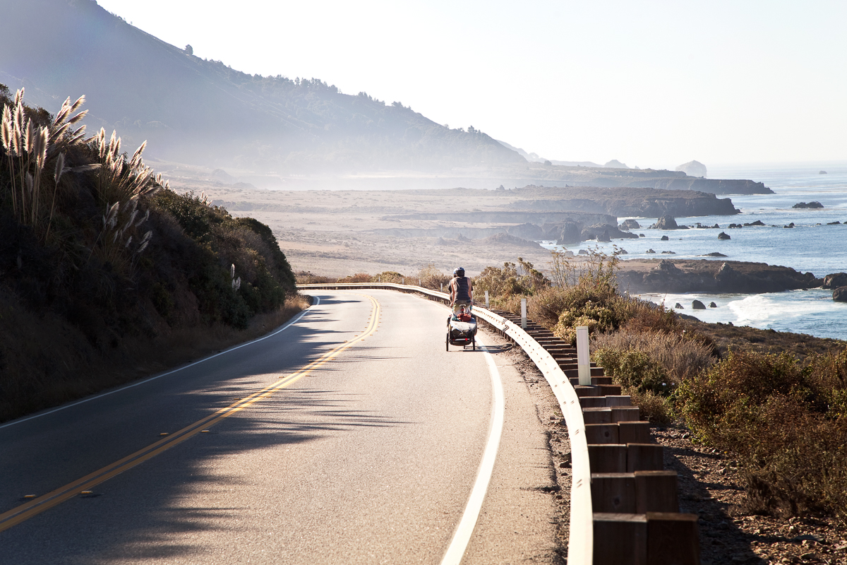 Tom and Devon pedaling through Big Sur California.
