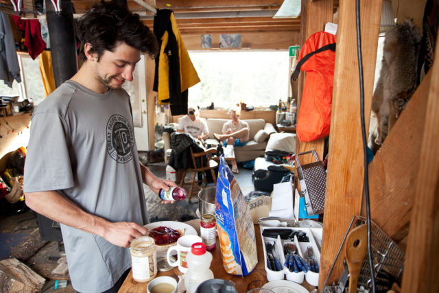 Alex Yoder preps some hotcakes in Ryland Bell's Haines AK Cabin. Down days yeilded lots of time stuffed in the cozy cabin and eating very hearty breakfasts. Plenty of napping too!